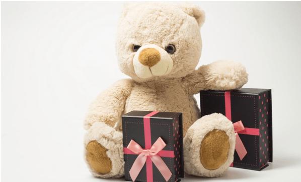 A Gift Hamper With A Teddy Bear